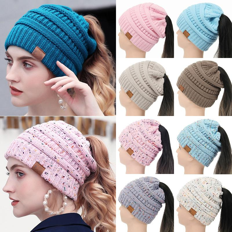 Drop Shipping 2018 Soft Knit Ponytail Beanie Women Warm Winter Hats For  Women Stretch Cable Messy Bun Hats Ski Cap With Tag Y18110503 Online with  ... fe63703278f