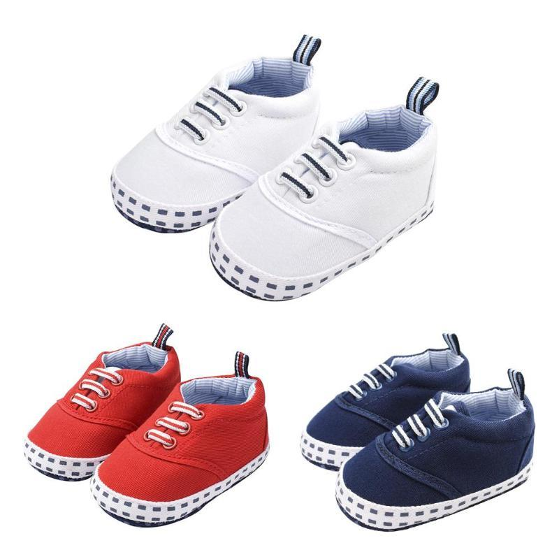 2019 Baby Prewalker Canvas Shoes Toddler Soft Sole Solid Color Anti Skid  Lace Up First Walkers Casual Sneakers For Toddler Shoes From Qwinner 4163883ac3b2