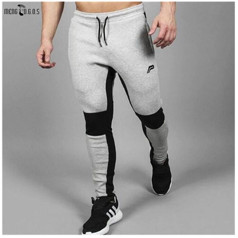 0650864e54eb6 Compre Pantalones Grises Para Hombres 2018 Pantalones Joggers Comprimidos  Gimnasios Casuales Ropa Deportiva Masculina Pantalones Pitillo A  38.56 Del  ...