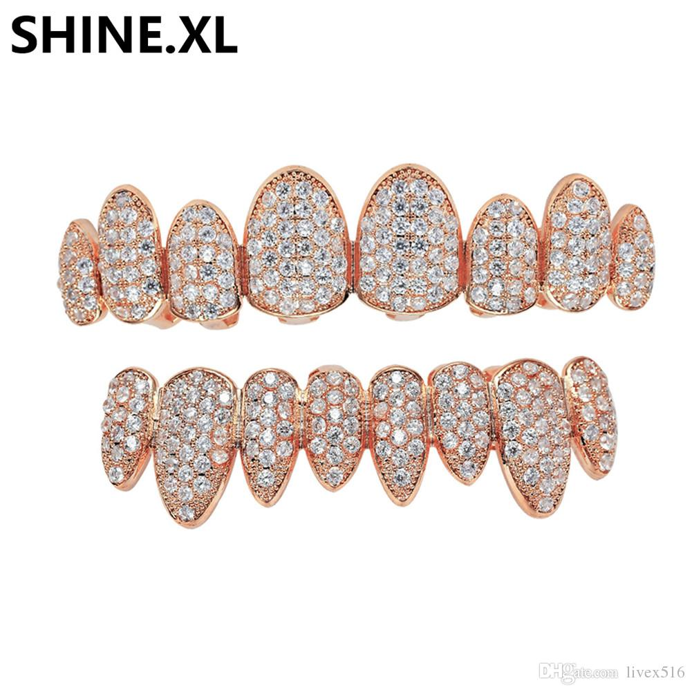 HIP HOP Iced Out Zircon Gold Teeth Grills 8 Top   Bottom Tooth Grills  Dental Cosplay Vampire Teeth Caps Rapper Party Jewelry Gift UK 2019 From  Livex516 8580384f5