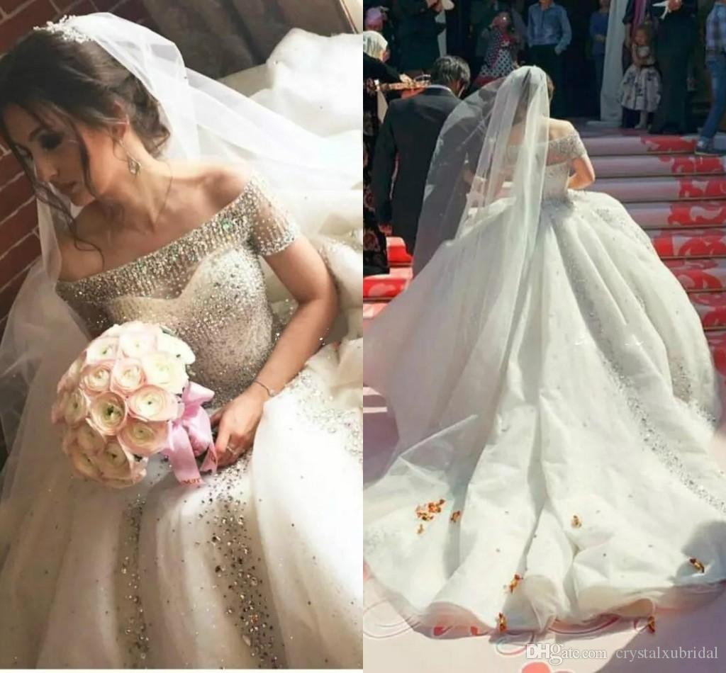 2018 Ball Gown Wedding Dresses Arabic Bling Off Shoulder Short Sleeves  Illusion Tulle Beads Crystal Rhinestones Cathedral Train Bridal Gowns  Vintage Wedding ... 98a0ab52d061