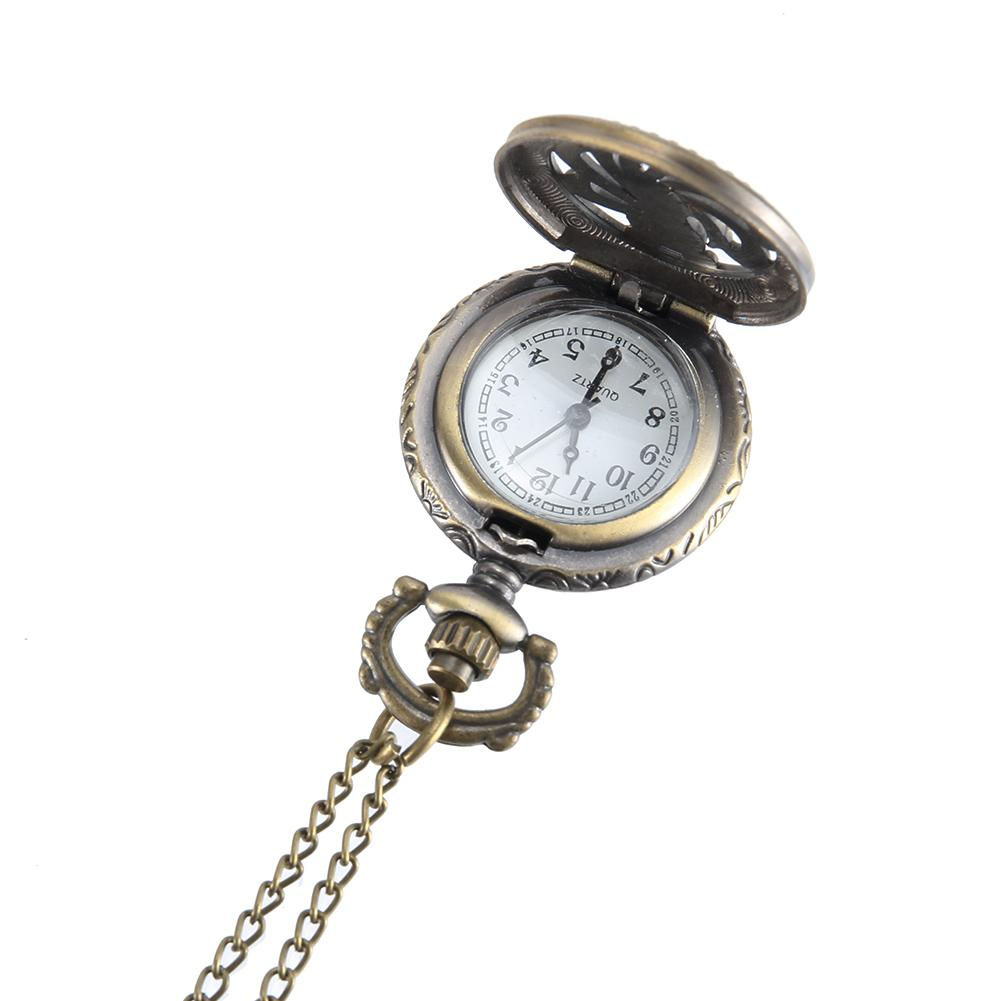 35f810bfa19b Compre Reloj De Bolsillo Vintage Color Bronce Reloj De Cuarzo Cadena Fresca  Cubierta De Pavo Real Hueca Relojes   88 A  37.27 Del Runyutian