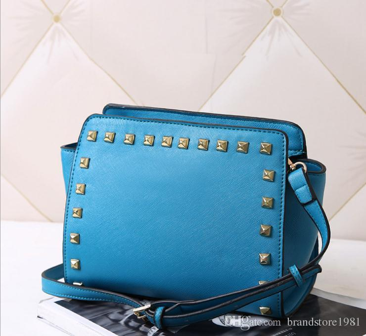 Factory direct sale 2018 classic single shoulder bag fashionable rivets smiling face pack Europe and the United States wings one shoulder as