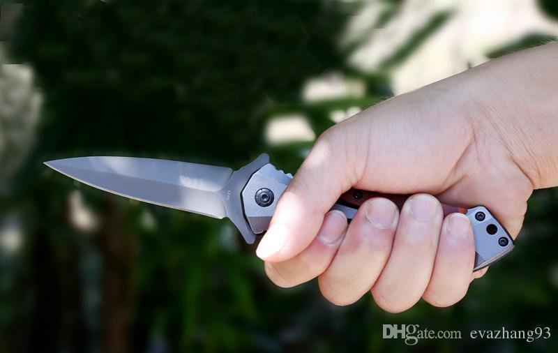BM DA27 Cuchillo plegable Superficie de titanio Incrustación de madera dura Mango Caza Herramienta manos de camping Cuchillo de combate Envío de la gota