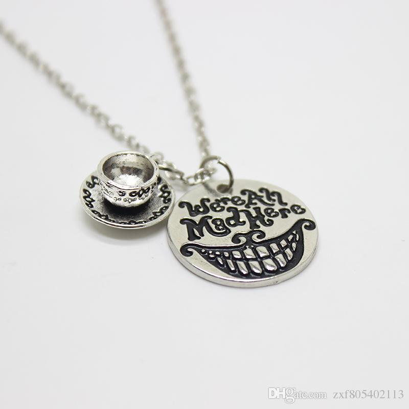 """Alice In Wonderland Necklace""""we're All Mad Here""""Hand Stamped Letter Pendant necklace cup charm Cat Smile Gift Fairytale Jewlery"""