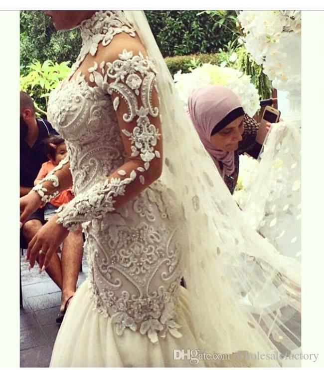 Azzaria Haute Sheer Mangas largas Vestidos de novia 2018 Illusion Nigeria High Cuello Apliqueado Dubai Arabic Castle Mermaid Body Batch