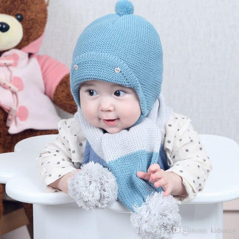 7b2e073a127 2019 Infant Baby Kids Hat Autumn Winter Beanies Caps Ball Beanie Knitted Hat  Lace Up Babies Children Warm Casual Cap Hats A169 From Kidsaccy