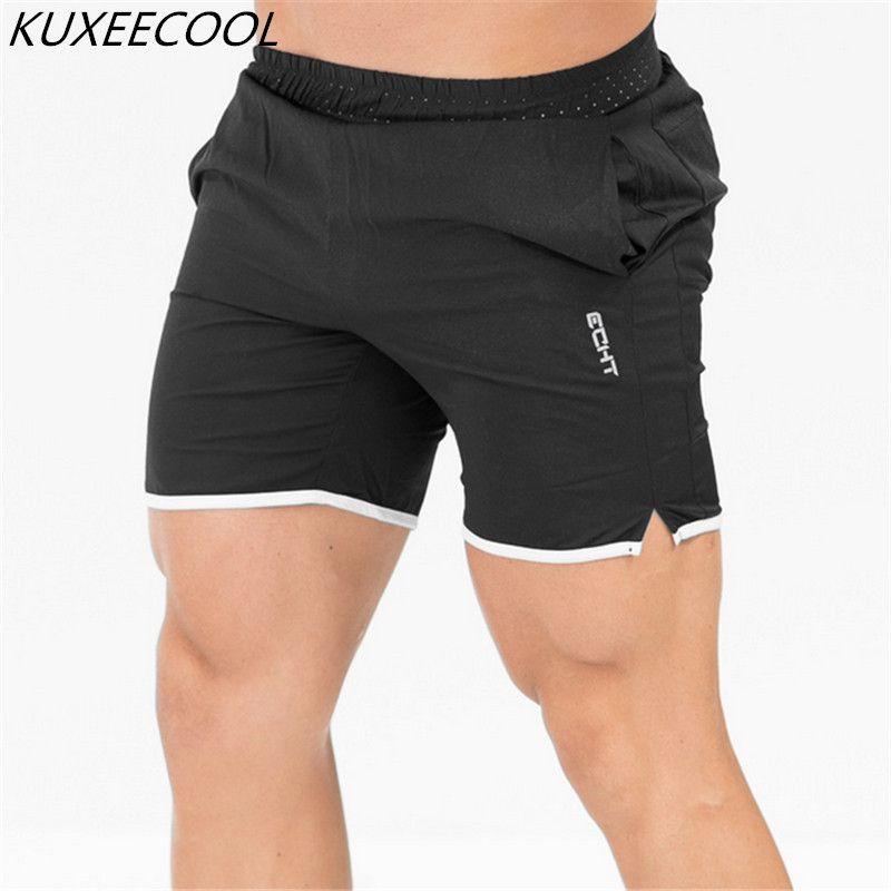 Compre NUEVA Marca De Verano Para Hombre Jogger Sporting Thin Shorts Hombres  Culturismo Negro Pantalones Cortos Para Hombre Fitness Gyms Shorts Para ... 545cd784ee32