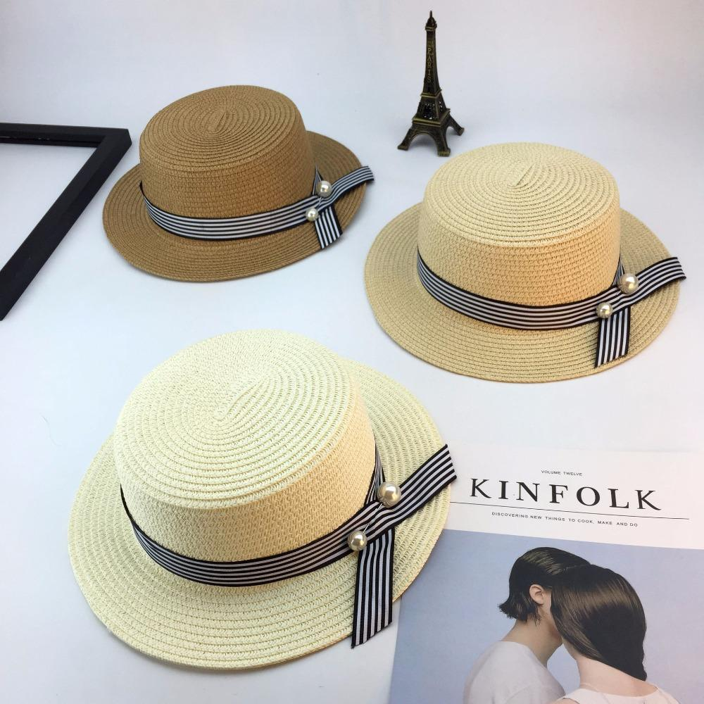 9963abfacdb38 Fashion Women Hats Wide Brim Straw Hats EleBlack White Striped Bow With  Pearls Summer Sun Ladies Beach Cap Flat Hat Store Fedora Hats For Men From  Haydene