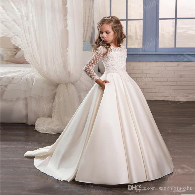 c890973960 Compre Vestidos Blancos Para Niñas Manga Larga Apliques De Encaje Vestidos  De Flores Para La Boda Vestido De Comunión Para Niñas Tamaño 2 13Y A  80.39  Del ...