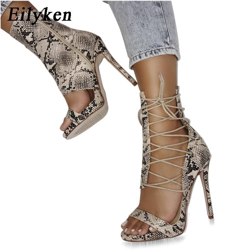 a6df25e26 Eilyken Gladiator Talons Hauts Léopard Sandales Femmes Sexy Sandale Design  De Mode Bout Ouvert Lacets Up Pompes Chaussures Femme Bottes
