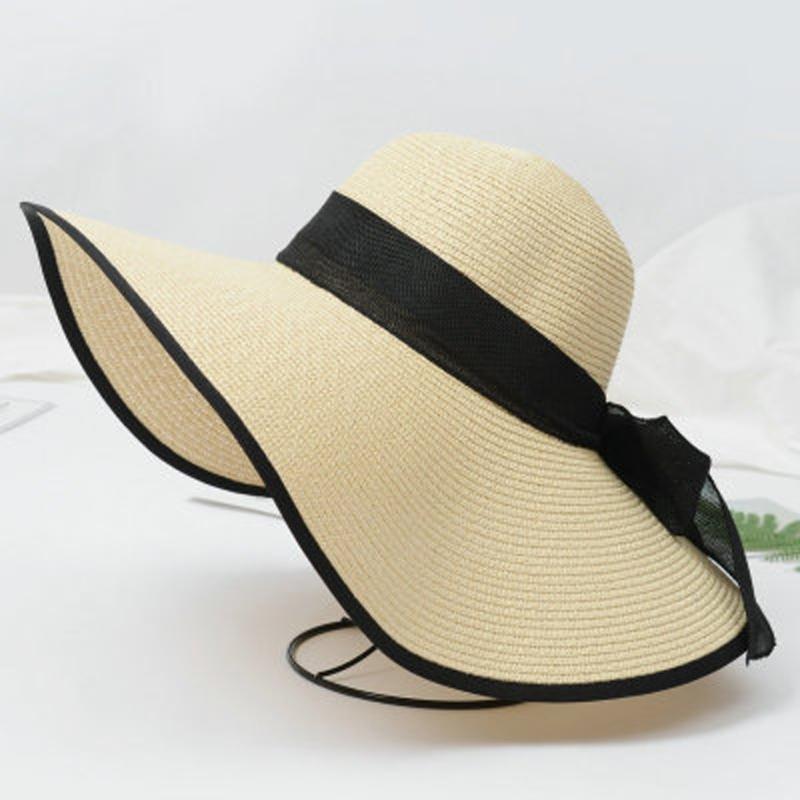 d3014179a74 Women Wide Large Brim Cap Floppy Fold Summer Beach Sun Hat Straw Ribbon  Fashion Wide Brim Hat Tea Party Hats From Wutiamou