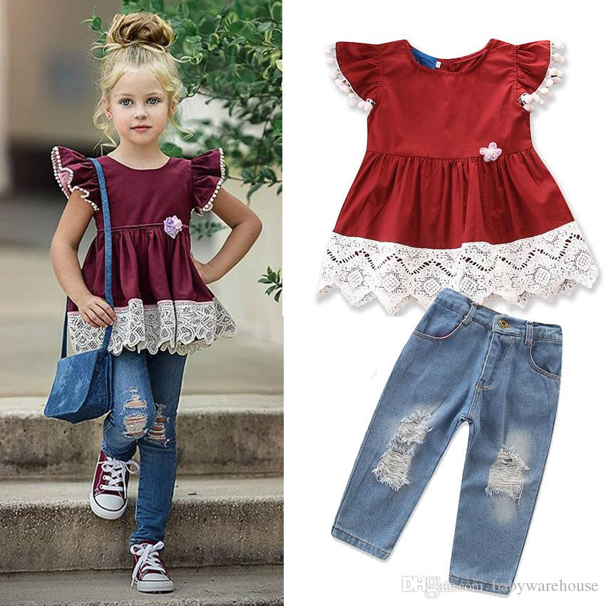 9415d6efca57 Moda 2018 Ropa para niños Ropa de manga corta con borlas Tops de encaje  Pantalones vaqueros Pantalones 2PCS Ropa para niñas Conjunto Trajes Ropa  para ...
