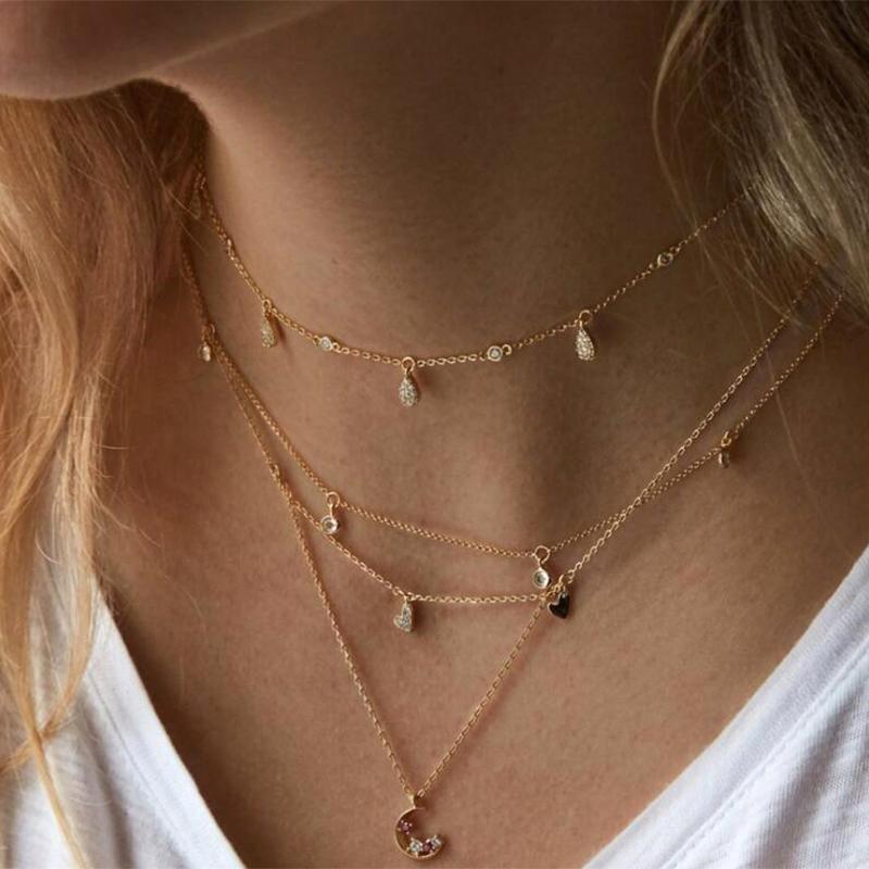 ffa2932dd29e Compre 2018 Cadena De Capas Simples Collar De Luna Para Las Mujeres De Oro  Gargantilla Larga Bohemio Snap Multi Capa Colgante Collar De Joyería De  Navidad A ...