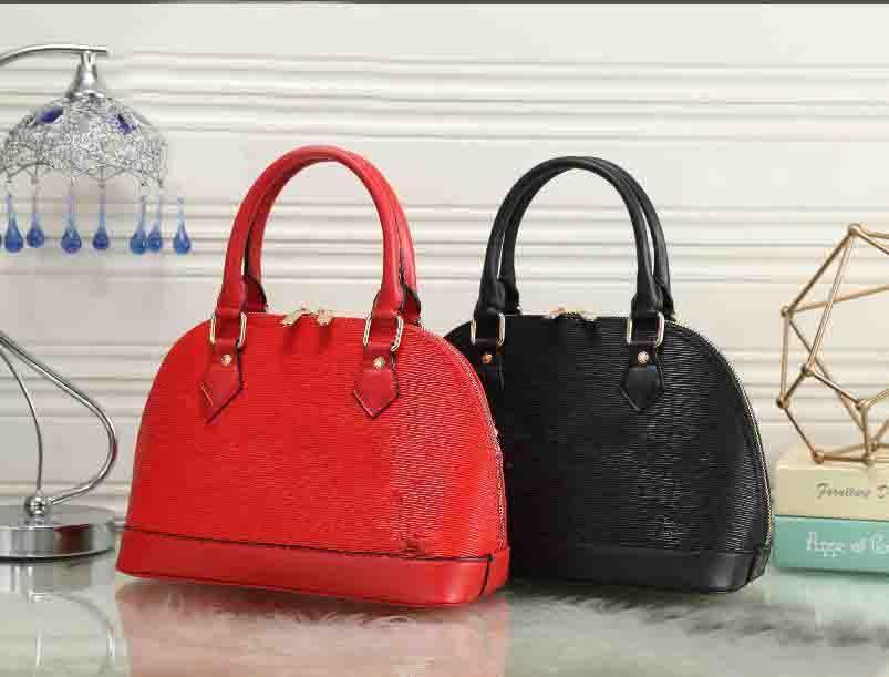 e5a98d0fff3 2018 Wholesale-Hot style Sell High quality newest fashion designer cross  pattern handbag chain shell bag, shoulder bag Free Shipping