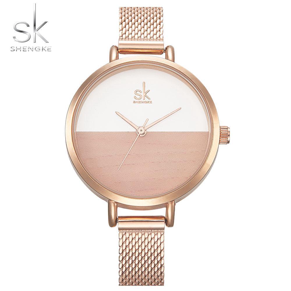 7b84ade8906a Compre SK Nuevas Mujeres Relojes Marca De Lujo Reloj De Oro Rosa Reloj De  Cuarzo Mujeres Creativo Patrón De Madera Dial De Moda Reloj De Pulsera  Montre ...
