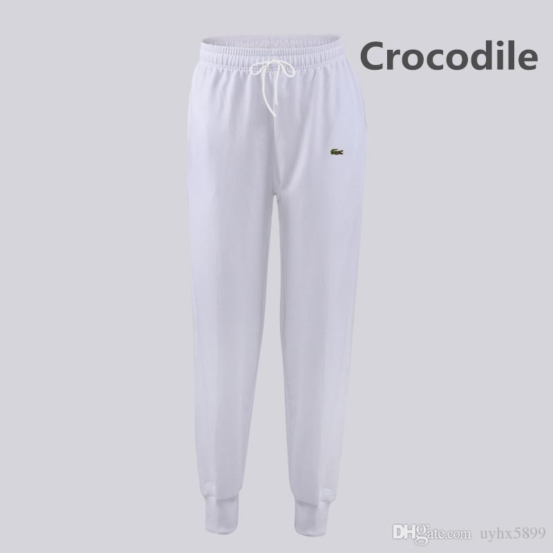 443e9520edea6 Compre Nueva 2018 Moda Marca Cocodrilo Bordado Pantalones De Los Hombres  Delgado Color Sólido De La Elasticidad De Los Hombres Pantalones Casuales  Hombre ...