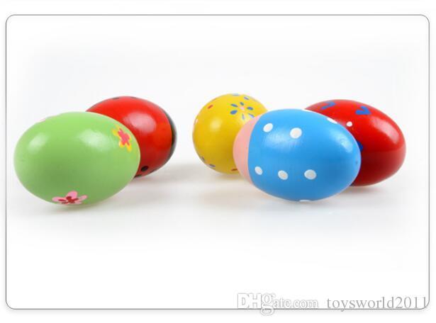 8 * 5CM Uova di Pasqua in legno Percussioni musicali Uovo di maracas Agitatori bambini Giocattoli bambini - Colori assortiti