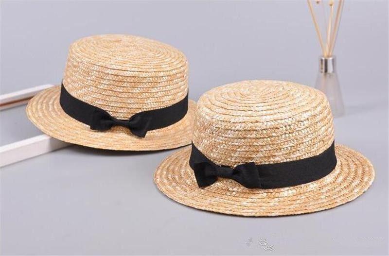 2018 Cute Child Girls Boy Straw Bowknot Sun Hat Kids Large Brim Beach  Summer Boater Beach Ribbon Round Flat Top Fedora Hat K0176 Cute Child Girls  Boy Straw ... 9a16bea5ad76