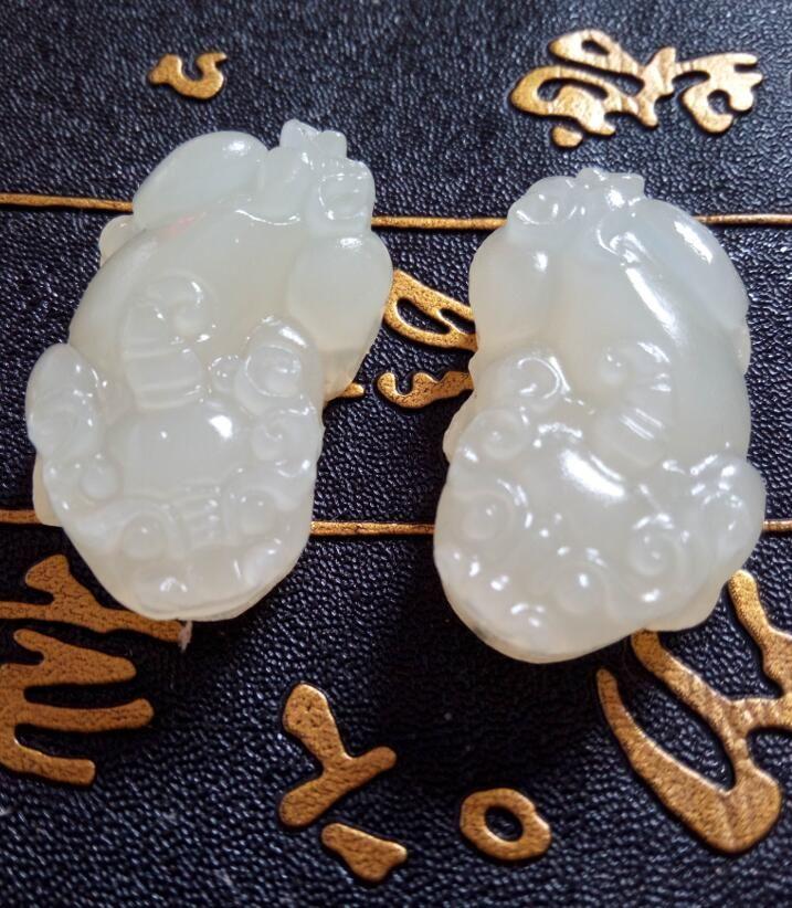 Xinjiang jade blanco Hotan de China el amantes del animal salvaje mítico paz colgante con A4 libera el envío