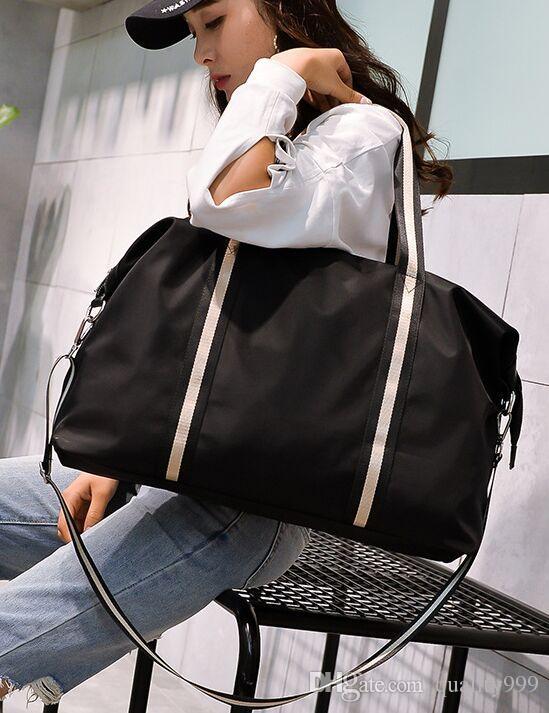 2018 New Fashion Sports Duffel Bags Women Oversized Shoulder Bag Short  Distance Travel Bags Casual Handbag Men Messenger Bag Shoulder Bags Man Bags  From ... a5325bfa8cf59