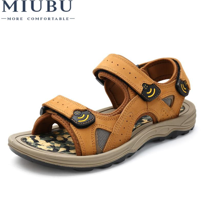 3277700d68c MIUBU New 2019 Summer Men Sandals High Quality Genuine Leather Men Slippers  Comfortable Fashion Sewing Beach Shoes Fringe Sandals Silver Wedges From ...