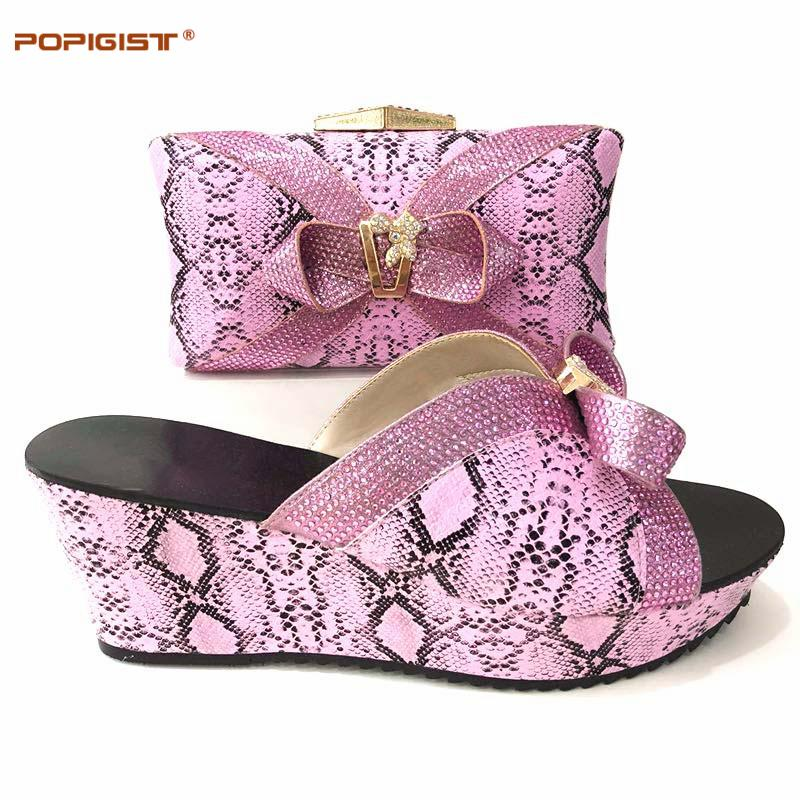 compre zapatos de boda de color rosa de nigeria y bolso para