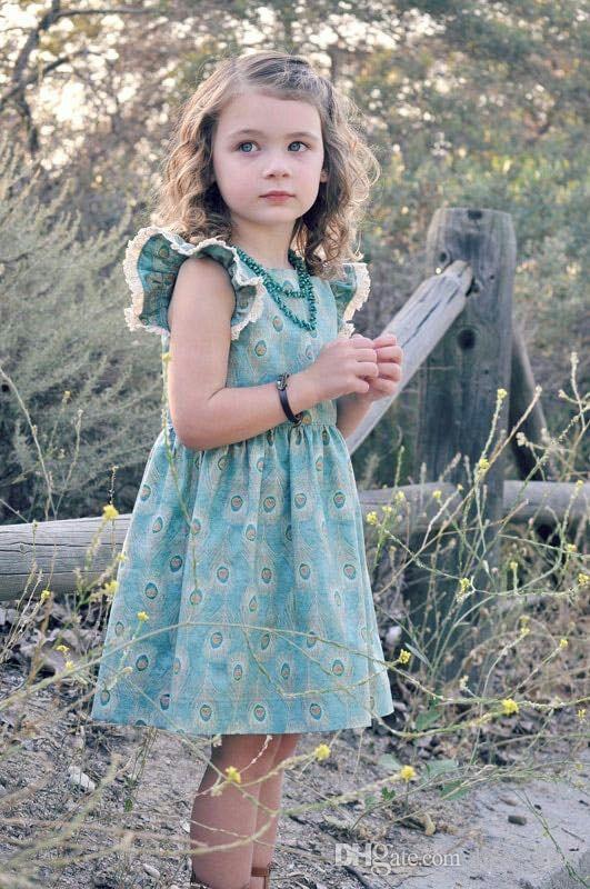 2018 nuevo estilo niños vestidos de verano ropa BOUTIQUES Niñas volando mangas cortas vestido bebé niña pelo de pavo real impresa princesa falda