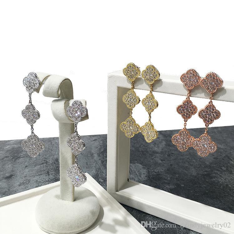 bb4a92878658 Compre 2018 Marca De La Venta Caliente De Cobre Chapado En Oro Brillante  Trébol De Cuatro Hojas Tres Flores De Diamantes Pendientes Completos  Tricolor ...