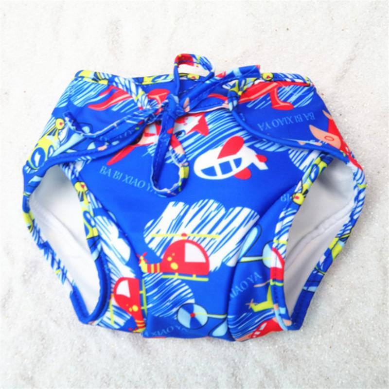 c9b3776a62cb3 2019 Cartoon Print Leak Proof Swim Trunks 0 3 Years Baby Swimming Shorts  Infant Boys Girls With Bow Flower Baech Swim Pants From Rainbowny, $42.31 |  DHgate.