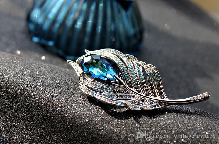Broche en forme de feuille de plume de paon en forme de broche de cristal broche utilisée par les femmes et les hommes YP3359