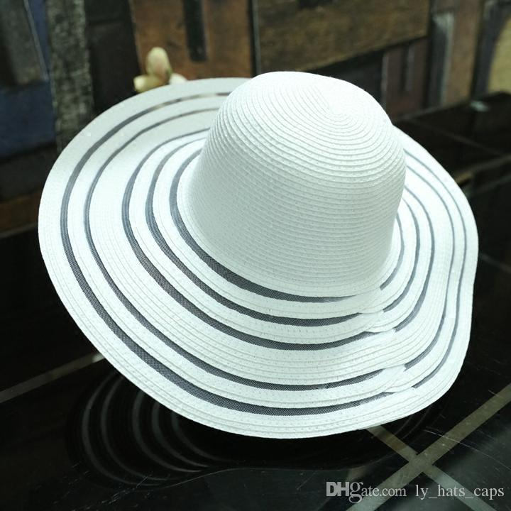 fce8bd1cd32b5 Good Quality Cheap Promotion Women Girl Woman 2018 Fashion Summer Straw Hat  Long Big Brim Foldable Floppy Sun Hats Beach Caps Boonie Hat Fedoras From  ...