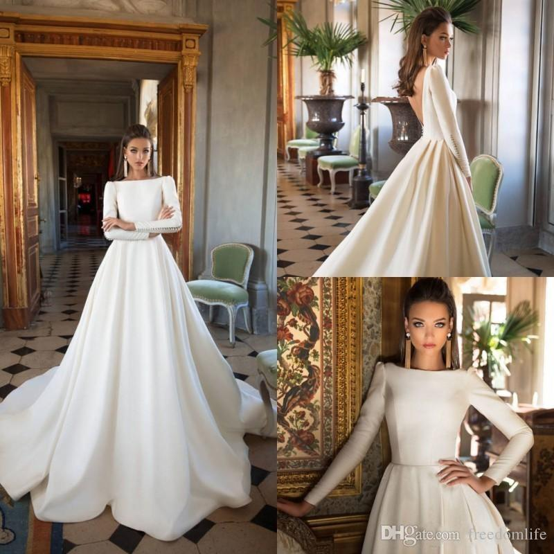 76dd4e98aee8a Discount 2018 Modest Wedding Dresses Long Sleeve A Line Satin Backless  Sweep Train Wedding Gowns Bateau Neck Winter Plus Size Bridal Dress A Line  Strapless ...