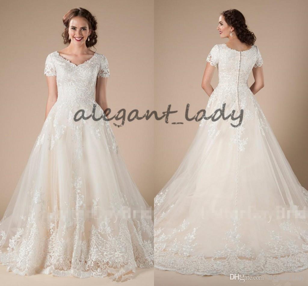 Una línea de tul de encaje Vestidos de novia modestos de la vendimia con mangas cortas Apliques País Formal Vestidos de boda occidentales Vestidos de novia de templo