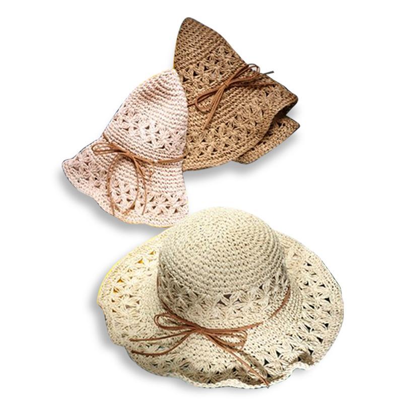 Compre GGOMU Nueva Mano De Verano Crochet Hollow Flor Sombreros Para El Sol  Para Las Mujeres Bowknot Ala Ancha Moda Niñas Sombrero De Paja Sombrero De  Playa ... d137031b523e