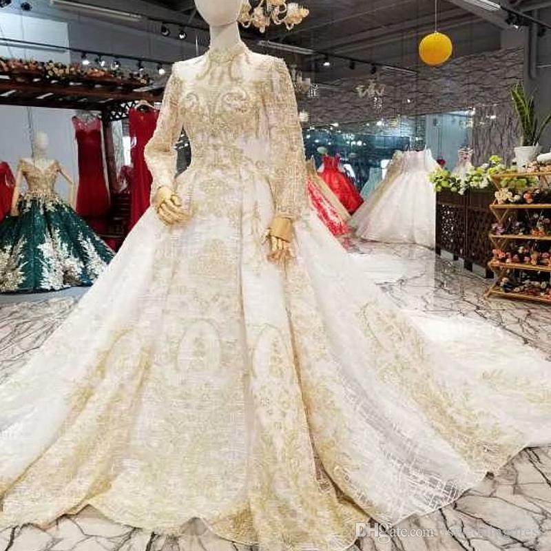 Luxury Dubai Wedding Dresses Gold Lace Applique High Neck Long Sleeve  Transparent Back Bride Gown For Wedding Party Real Price Silver Wedding  Dress Wedding ... 6bb7aea0905a