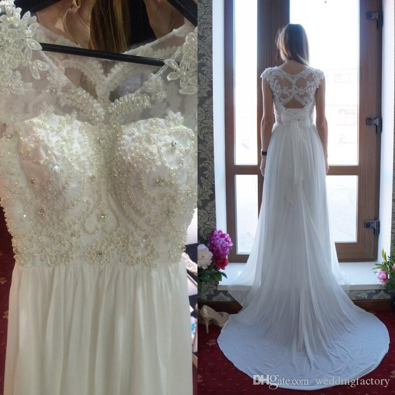 Stunning Bohemian Beach Wedding Dress Sheer Neck Sleeveless Open Back  Pearls Beaded Lace Appliques Chiffon Bridal Gowns with Bow Sweep Train  Bohemian ... 5b7f80c5c513