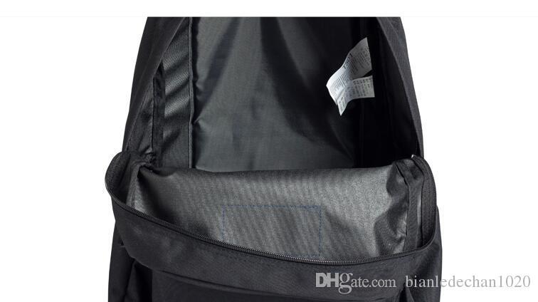 JanSport Jieshibi T501 negro y gris rebelde universitario viento hombres y mujeres bolsa de marea del bolso del estudiante bolsa