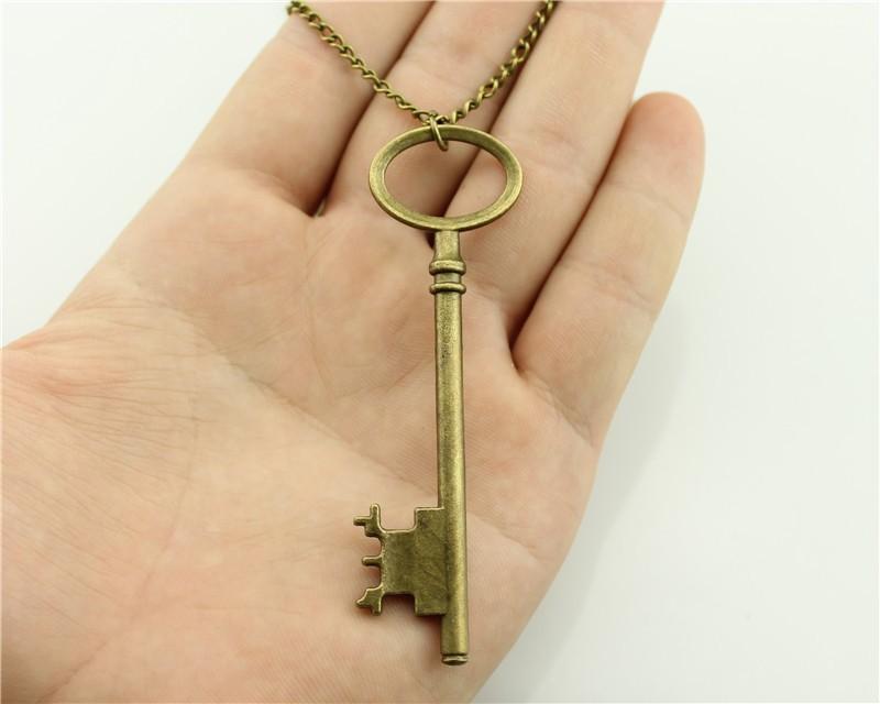 WYSIWYG Collana a pendente con chiave antica color bronzo antico 79mm, collana lunga catena da 70cm