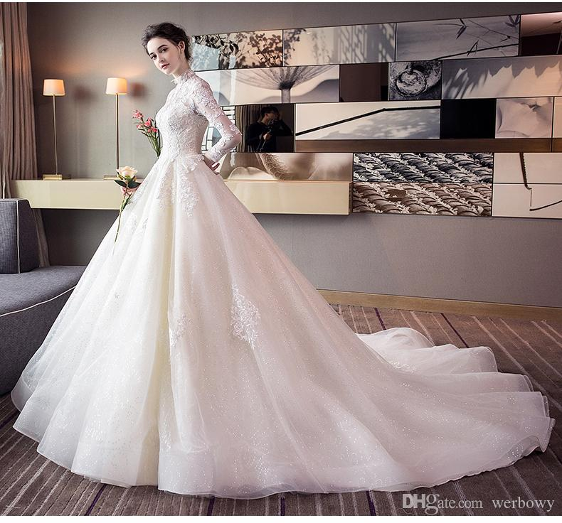 2019 Free Freight High-Quality Wedding Dresses White Translucent Long-Sleeved Collar Qi Large Tail Lace Applique Beach Dresses HY080