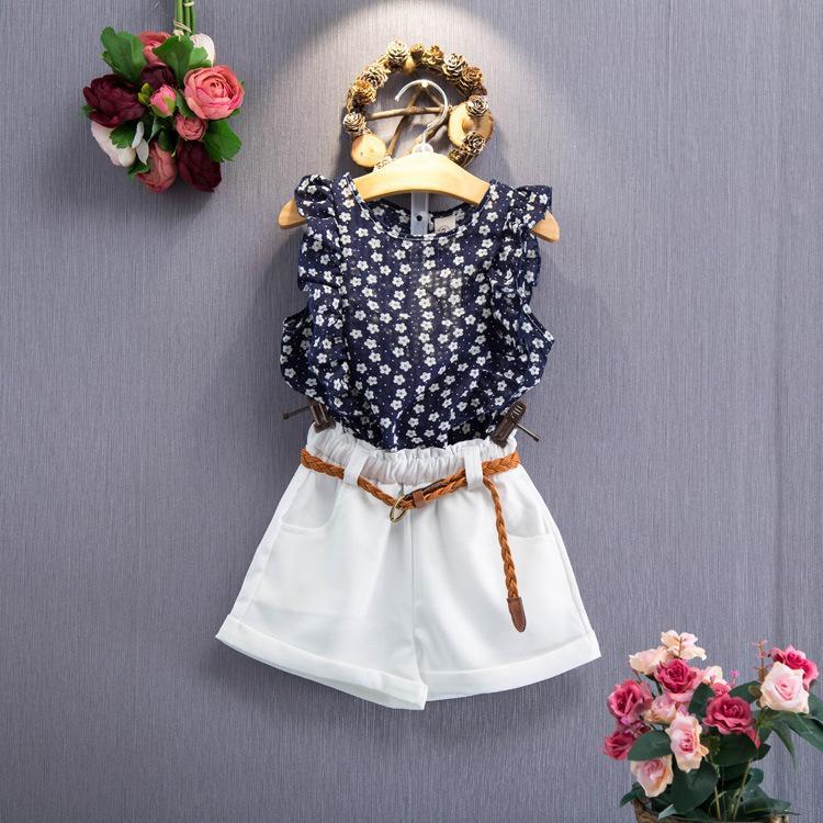 c6f8b096b Camiseta sin mangas floral de las muchachas + pantalones cortos conjunto  ropa del verano de la niña del niño trajes de la ropa de la niña ropa de ...