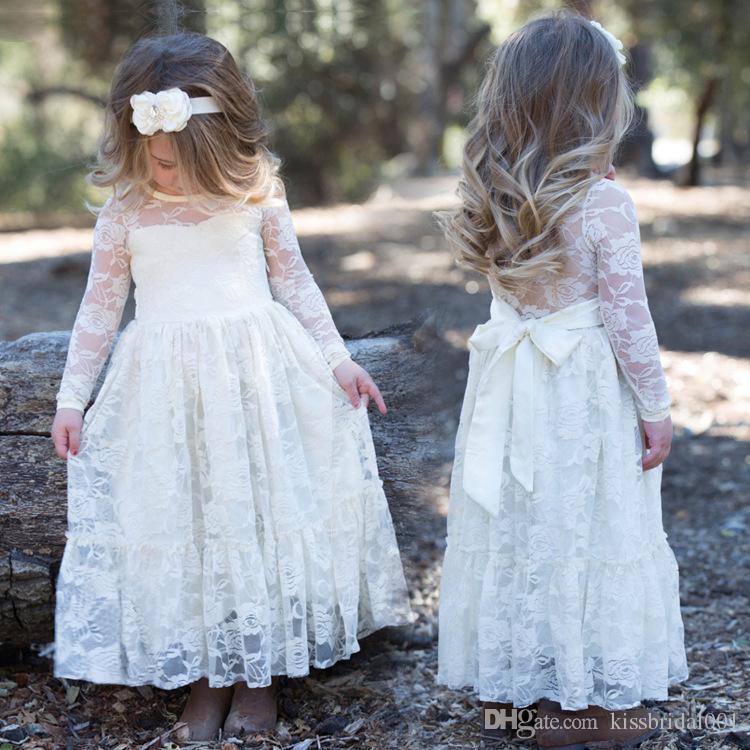 Lindos vestidos de flor de encaje de marfil vintage para niñas Mangas largas Arco trasero Longitud del piso Vestidos de comunión baratos