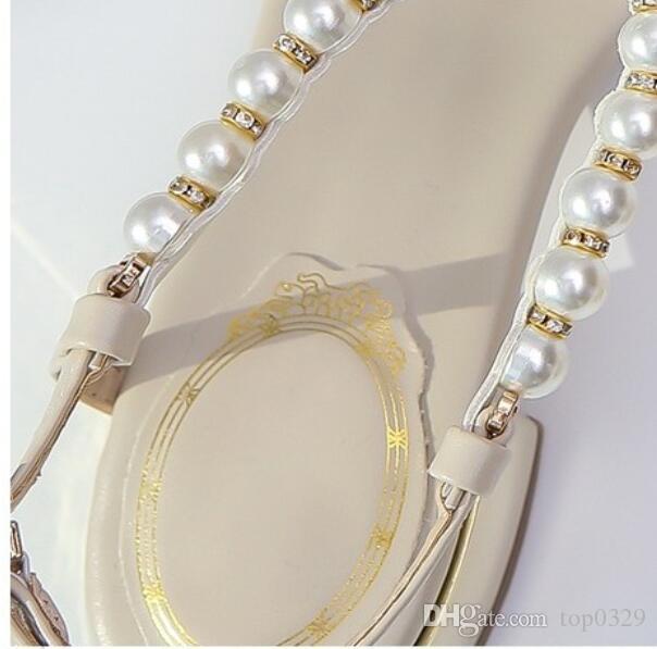 Frauen-Sandelholztop-Qualität Butike-Reise-einfacher Luxus-Diamantbogenperle Mode-Marken-flacher Strand-reizvolle Damen OL beiläufige Sandelholze