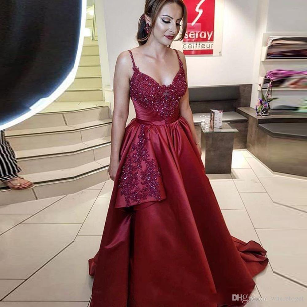 Compre Sexy Rojo Oscuro Borgoña Una Línea Larga Árabe Prom Vestidos  Spaghetti Strap Con Cuentas Y Lentejuelas Vestido De Noche Ruffles Satén Vestido  De ... cd65b7c1cd1e