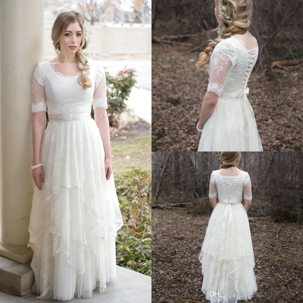 Discount Stunning Spring Bohemian Boho Wedding Dresses Lace Tulle Ball 2018  Vestido De Novia Garden Short Sleeves Sheer Bridal Gown Plus Size Arabic  Wedding ... 2afc2d323