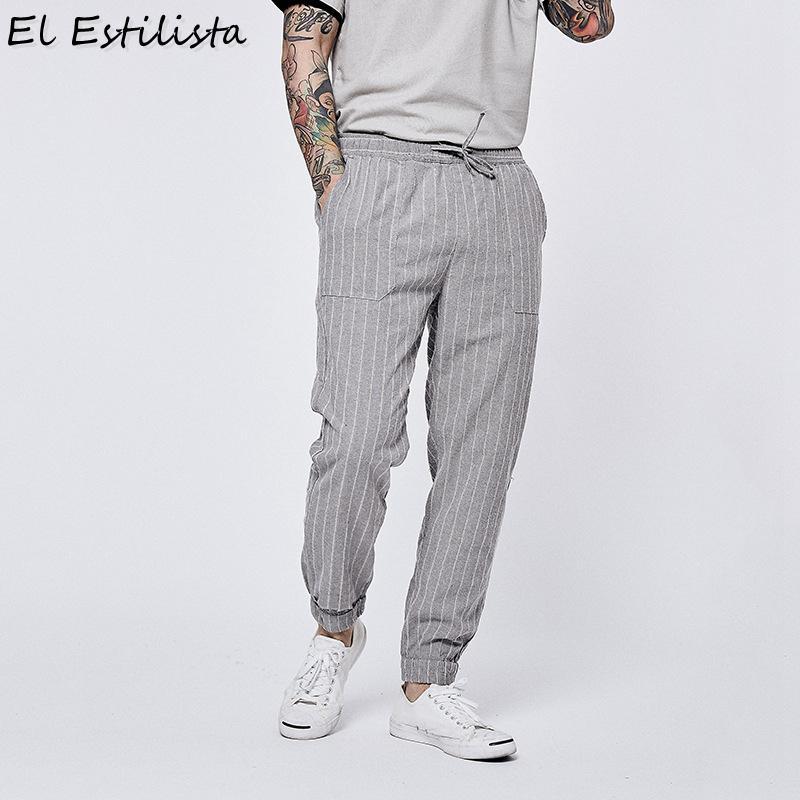 87ca23cbb5 Pantaloni di lino a righe larghi Pantaloni di lino a strisce larghi  Pantaloni a vita semplice elastici da uomo Slim Fit Streetwear Pantaloncini  estivi ...