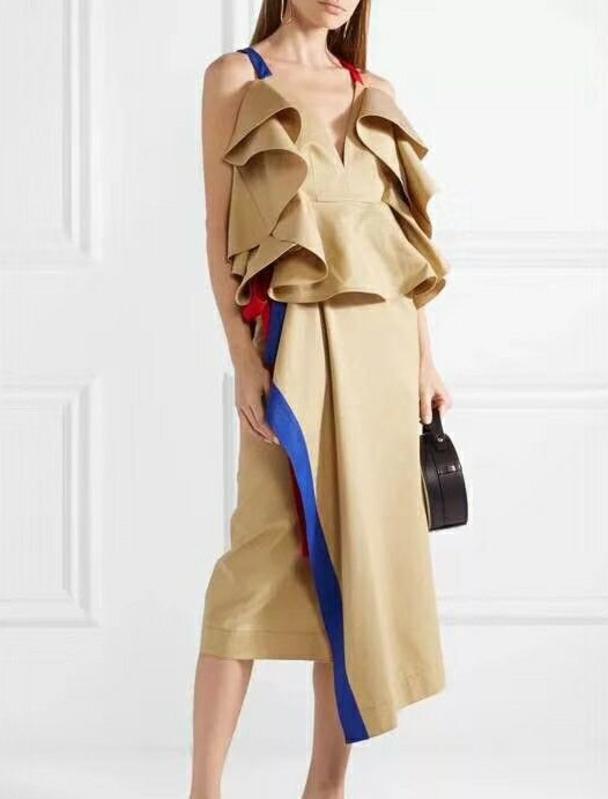 Compre qlzw Alta Calidad 2018 Verano Nueva Moda Hit Color Correa Tops +  Falda Irregular De La Colmena De Dos Piezas Del Vestido De Las Mujeres  Conjunto ... 1f822f7589bd