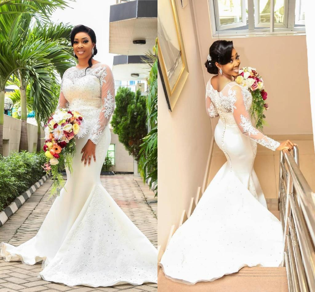 African Dubai Arabic Luxury 2018 Mermaid Wedding Dresses Lace Applique Beads Sequined Long Sleeves Sweep Train Wedding Dresses Bridal Gowns
