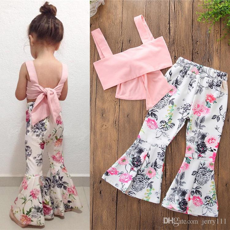 2cffeb45df39 INS Hot Girls Summer Suit Lovely Pink Bowknot Vest+White Flowers Flare  Trousers 2 pcs/set 2-6 years old Girls Summer Clothing Sets LA635