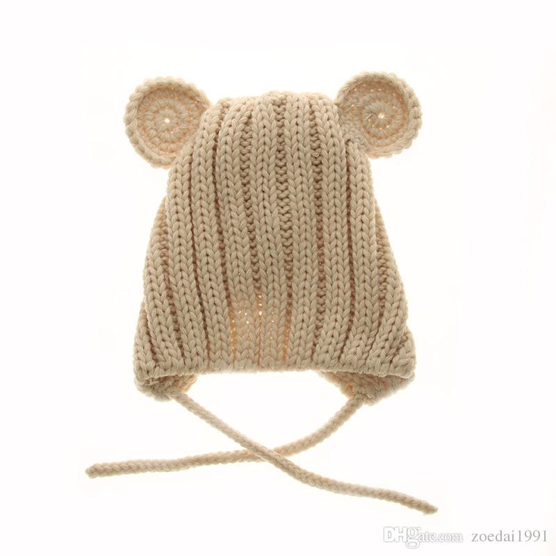 a08a1dab41a 2019 Girls And Boys Cute Cartoon Winter Bear Baby Hat Children Ear Hand  Knitting Wool Cap Sleeve Head Infant S Beanies Headwear From Zoedai1991